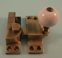 THD104/AB Straight Arm Fastener - Standard - Ceramic Knob in Antique Brass
