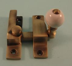 THD104N/AB Straight Arm Fastener - Narrow - Ceramic Knob in Antique Brass
