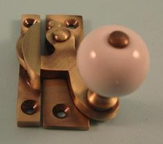 THD108/AB Clo Fastener - Ceramic Knob - Non Locking - Antique Brass