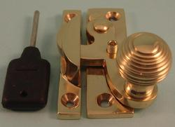 THD113L/PB Claw Fastener - Reeded Knob - Locking in Polished Brass